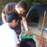 Shane and Spencer try their baking skills out making a colourful pizza in the traditional clay oven at 'Growing for Life'. Did they share it?
