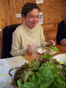 Ray tucks into a healthy salad that she harvested for everyone to enjoy and share in the Country Log Cabin at 'Growing for Life'.