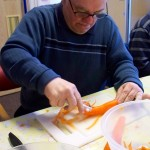 Paul peels the veg for the group shared lunch.